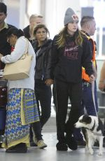 Bella Thorne and new girlfriend Alex Martini hold hands before flying out of Toronto