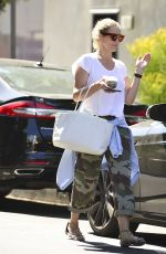 Cameron Diaz Makes a dash back to her car to avoid a parking ticket after picking up food to go in Los Angeles