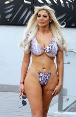 Chloe Ferry Shows off her curves by the pool on holiday in Dubai