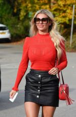 Christine McGuinness Showing off her long legs in a short leather skirt as she is spotted out and about in Alderley Edge in Cheshire