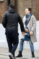 Claire Foy and co-star Matt Smith put on a very playful display as they hold hands and head for lunch together in London