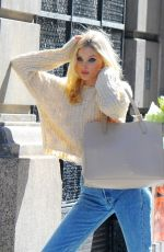 Elsa Hosk Posing in several different outfits during an photoshoot in New York City