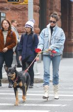 Emily Ratajkowski Seen taking a stroll with her dog in New York