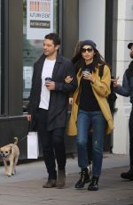 Gemma Chan and Dominic Cooper looked besotted as they strolled arm-in-arm after grabbing a coffee in Primrose Hill, north London
