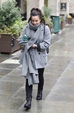 Georgia May Foote Is seen all wrapped up from the cold in a huge grey scarf and grey coat out and about in Manchester