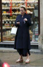 Gillian Anderson On her phone outside a Sainsbury