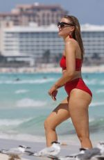 Grace Levy Looks stunning in a two piece red bikini while in Tulum Mexico