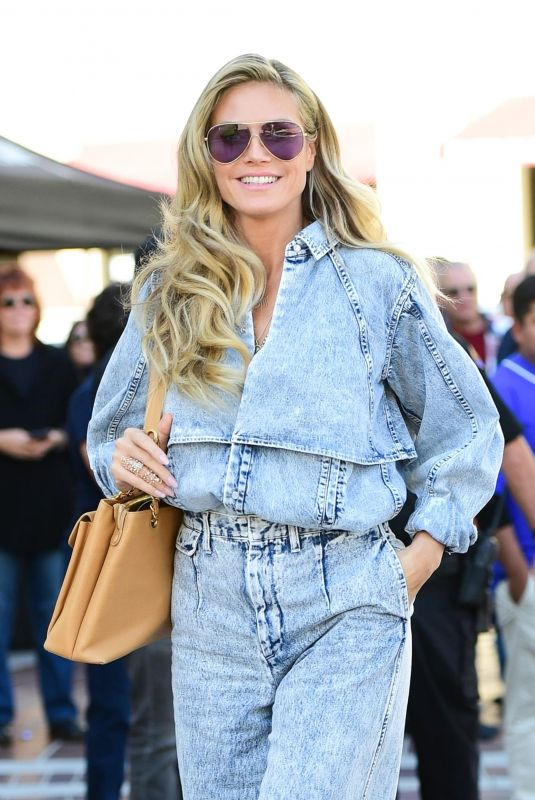 Heidi Klum Stuns in a double denim look outside Convention Center