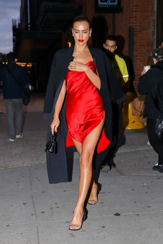 Irina Shayk Showcases her long legs in a red satin dress while leaving a Photoshoot in New York City