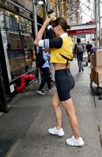Irina Shayk Wears bicycle tights and yellow sport top in New York City