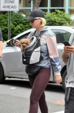 Katy Perry Carries her adorable micro teacup Poodle Nugget in Washington
