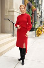 Kennedy McCann Stunning in a red knit dress as she leaves Buzzfeed in New York City