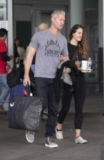 Lana Del Rey Arrives with cop influencer boyfriend Sean Larkin at the JFK airport in NYC
