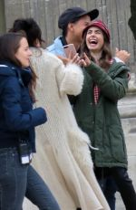 """Lily Collins & Ashley Park Seen filming """"Emily in Paris"""", a serie directed by Darren Star in Paris"""