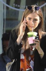 Lily Collins Cuts a casual figure in longline blazer and jeans as she steps out for a healthy green juice in West Hollywood