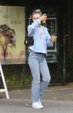 Lily-Rose Depp Picking up Coffee at Aroma Cafe in LA