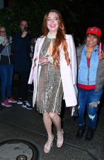 Lindsay Lohan Is all dressed up as she heads out from the Mercer Hotel in New York