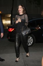 Lizzy Caplan In a leather pants and a coach bag