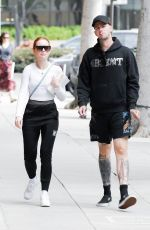 Madelaine Petsch and Rapper Boyfriend Travis Mills are seen taking a stroll after leaving a medical building in Los Angeles