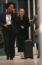 Mary-Kate & Ashley Olsen Arrive at JFK airport in New York City