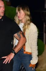 Miley Cyrus All smiles as she leaves a dinner date in Malibu
