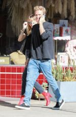 Miley Cyrus Hold hands with Cody Simpson as they go out for lunch in Los Angeles