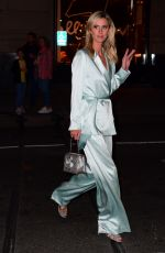Nicky Hilton Turns heads as she arrives to a CFDA Cocktail Party in New York wearing atunning aquamarine satin suit