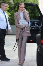 Rosie Huntington-Whiteley Exits her vehicle and enters a building in Beverly Hills