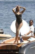 Shanina Shaik In a black swimsuit as she posed up out on a boat out in the Greek sunshine