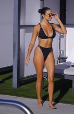 Tao Wickrath As the sun hits her curves on a hot day as she enjoys the pool at luxury hotel in Miami Beach