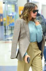 Victoria Beckham Struts through JFK airport as she touches down in New York