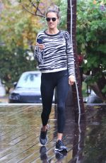 Alessandra Ambrosio Braves the rare LA rain as she heads to the gym