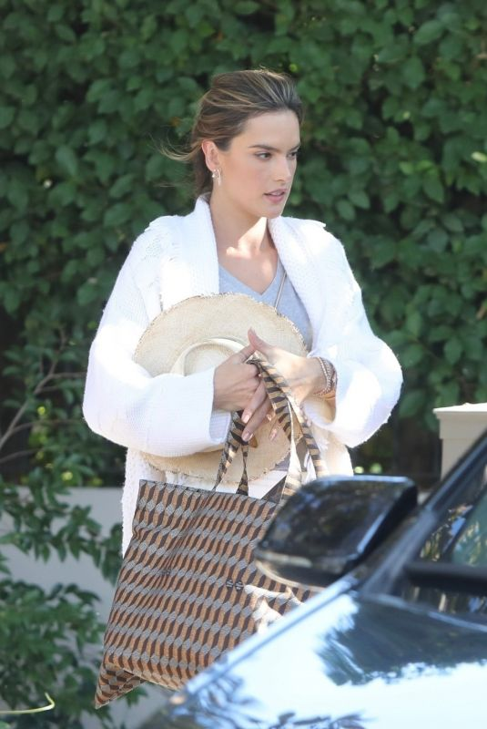 Alessandra Ambrosio Gets into a limo as she gets ready to head to LAX airport in Los Angeles