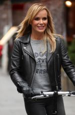 Amanda Holden Shows off her slim frame in black boots and denim trousers