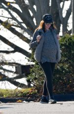 Anne Hathaway Cradles her growing baby bump in Westport, Connecticut