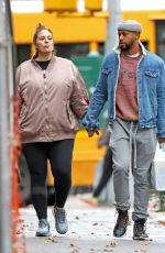 Ashley Graham Shows her growing baby bump while out with her husband Justin Ervin in New York City