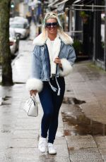 Christine McGuinness Wearing a very fluffy sleeved and collard jacket