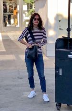 Courteney Cox Waits for her car at the valet after shopping at Club Monaco