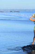 Courtney Stodden Hits the beach in Malibu and takes a spill while paddling in the ocean