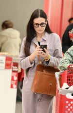 Demi Moore Shopping for a cart full of toys for possible holiday donation with her assistant in tow at Target