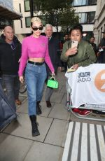 Dua Lipa Sports high wasted denim and a pink crop sweater as she is leaving BBC