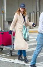 Emma Stone Arriving at JFK Airport sporting a cozy yet stylish look in NY