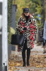 Emma Watson Makeup free in a mixed print fur coat as she heads to pilates class with a friend in London