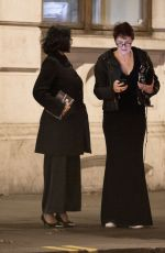 Fiona Shaw Cosies up to Sonali Deraniyagala as she tries to hail a cab after the Evening Standard Theatre Awards in London