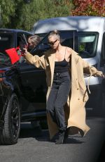 Hailey Bieber Almost takes a fall while out with a friend