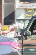 Hailey Bieber Gets coffee delivered to her car as she stops by Blue Coffee in Beverly Hills