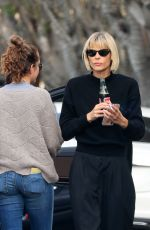 Jaime King Enjoys a cigarette a coke while out on Melrose Place