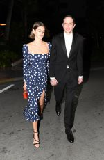 Kaia Gerber and Pete Davidson hold hands as they attend a friend