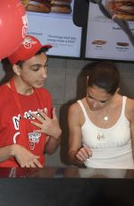 Katie Holmes Takes donations at McDonald