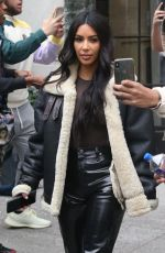 Kim Kardashian and Kanye West take care of business in the Big Apple